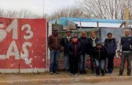 Juan Canessa junto a los vecinos del Barrio 513.
